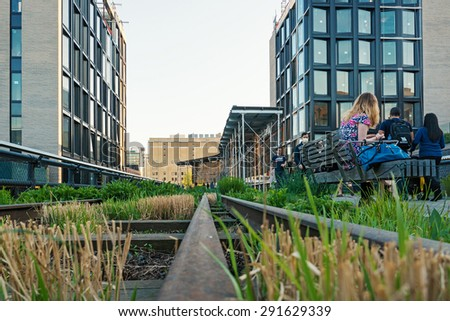 NEW YORK CITY - CIRCA MAY 2015: People walking on the High Line Park. The High Line is a park built on an historic freight rail line elevated above the streets in the West Side.