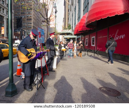 NEW YORK CITY - DEC 11:  Salvation Army workers perform for collections on Dec. 2, 2011 in Herald Square, NYC.  This Christian organization  is known for its charity  work, operating in 126 countries