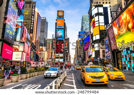 stock photo new york city dec times square is a busy tourist intersection of neon art and commerce and is 248799484 - Каталог — Фотообои «Улицы, переулки»