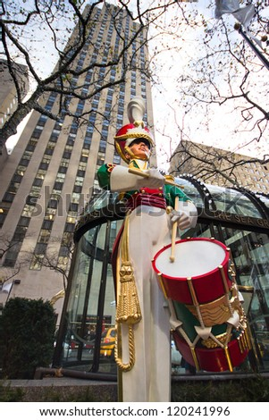 NEW YORK CITY - DEC 2: Toy soldier statue at Rockefeller Center in NYC on Dec 2, 2012. Declared a National Historic Landmark Rockefeller Ctr. is home to the iconic NYC Christmas Tree and skating rink. - stock photo