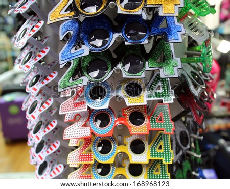 NEW YORK CITY - DECEMBER 28, 2013: Novelty glasses celebrating New Year\'s Eve 2014 on display at a shop in Times Square.