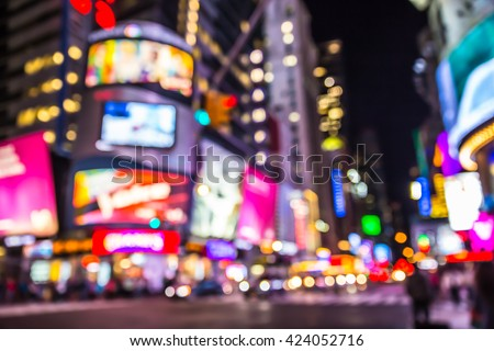 New York City defocused blur of Times Square lit up at night
