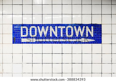 New York City Downtown subway station with mosaic sign with arrow. New York City, USA name tile pattern in subway station, metropolitan.