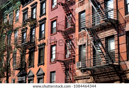 New York City East village building details with fire escapes #1084464344
