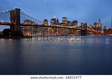 New York City evening skyline with Brooklyn Bridge