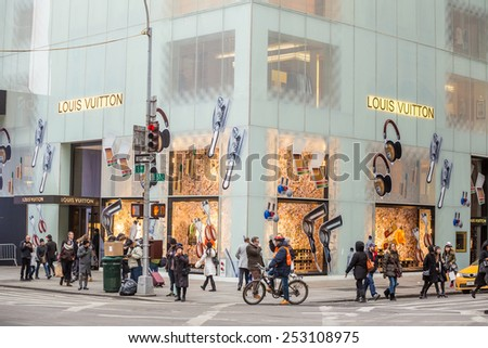 NEW YORK CITY - FEB 13: Shopping street at 5th Avenue in NYC with tourists on  February 13, 2015. It is considered among the most expensive and best shopping streets in the world.