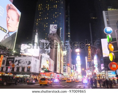 NEW YORK CITY - FEB 18: Times Square, featured with Broadway Theaters and animated LED signs, is a symbol of New York City and the United States, on February 18, 2012 in Manhattan, New York City (USA) - stock photo