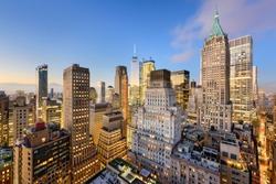 New York City Financial District cityscape at dusk.