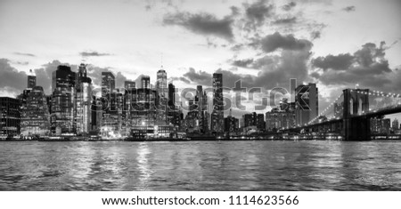 New York City, financial district in lower Manhattan with Brooklin Bridge at night, USA. BW #1114623566