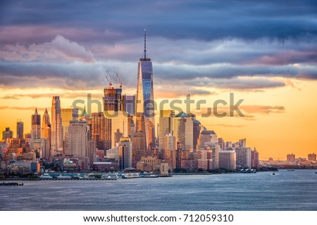 New York City financial district on the Hudson River at dawn. #712059310