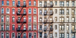 New York City historic apartment building panoramic exterior view with windows and fire escapes