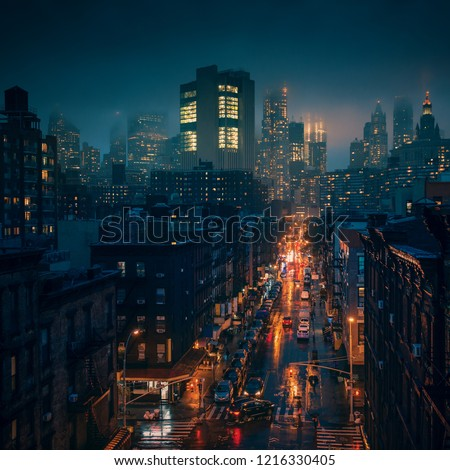 New York City in foggy raining weather at night. Streets of Chinatown at the storm.