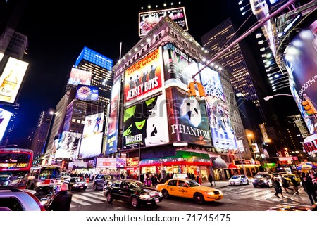 NEW YORK CITY - JAN 7: Nighttime in Times Square features with Broadway Theaters and is a symbol of New York City on January 7, 2011 in Manhattan, New York City. - stock photo