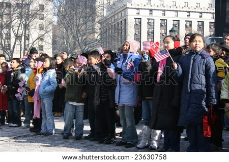 NEW YORK CITY, JANUARY 20, 2009 - Children watching the Presidential Inauguration of the 45th President of the United States, Barack Obama, at an outdoor event in Manhattan.