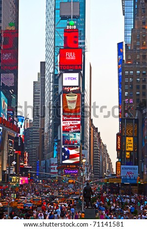 NEW YORK CITY - JUL 8: Times Square, featured with Broadway Theaters and huge number of LED signs, is a symbol of New York City and the United States, July 8, 2010 in Manhattan, New York City.