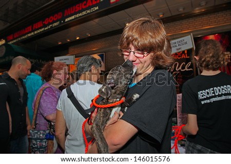 NEW YORK CITY - JULY 13 2013: Broadway Barks, an animal rescue organization founded by Bernadette Peters & Mary Tyler Moore, holds its annual fair in Shubert Alley on July  13, 2013 in New York City