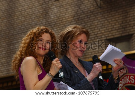 NEW YORK CITY - 14 JULY 2012: Broadway Barks marks its 14th year with a celebrity-studded adoption fair in Shubert Alley. Bernadette Peters (lt) & Mary Tyler Moore on 14 July 2012 in New York City.