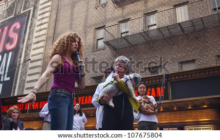 NEW YORK CITY - 14 JULY 2012: Broadway Barks marks its 14th year with a celebrity-studded adoption fair in Shubert Alley. Bernadette Peters & Rita Moreno with friend on 14 July 2012 in New York City.