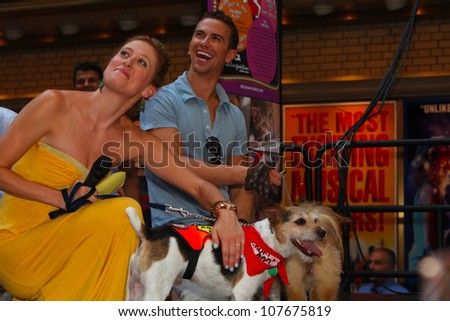 NEW YORK CITY - 14 JULY 2012: Broadway Barks marks its 14th year with a celebrity-studded adoption fair in Shubert Alley. Caisse Levy & Richard Fleeshman of Ghost on 14 July 2012 in New York City.