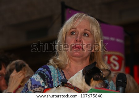 NEW YORK CITY - 14 JULY 2012: Broadway Barks marks its 14th year with a celebrity-studded adoption fair in Shubert Alley. Nancy Opel of Memphis with friend on 14 July 2012 in New York City. - stock photo
