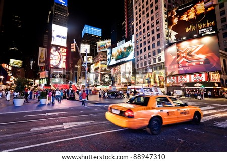 NEW YORK CITY - JULY 1: Moving taxi on Times Square featured with Broadway Theaters and animated LED signs is a symbol of New York City and the United States, July 1, 2011 in Manhattan, New York City.