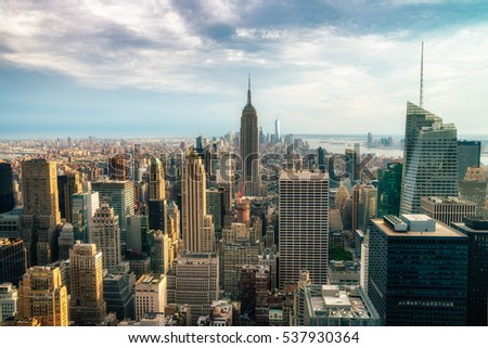 NEW YORK CITY - JULY 16,2016: Observers view Midtown from Top of the Rock Rockefeller center. Manhattan is often described as the cultural and financial capital of the world. Splittoned image. #537930364