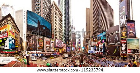 NEW YORK CITY - JULY 20: Panoramic shot of Times Square, busy tourist intersection of neon art and commerce and is an iconicplace of New York City and USA on July 20, 2012 in Manhattan, New York City. - stock photo