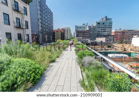 NEW YORK CITY - JULY 22: People walk along the High Line Park on July 22, 2014. The High Line is a popular linear park built on the elevated former New York Central Railroad spur in Manhattan.