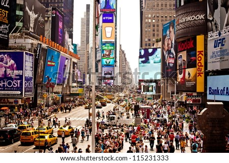 NEW YORK CITY - JULY 22: Times Square featured with Broadway Theaters and animated LED signs is a symbol of New York City and the United States, July 22, 2012 in Manhattan, New York City. - stock photo