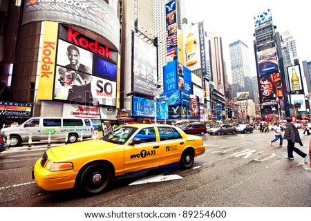 NEW YORK CITY - JULY 2: Times Square featured with Broadway Theaters and animated LED signs is a symbol of New York City and the United States, July 2, 2011 in Manhattan, New York City. - stock photo