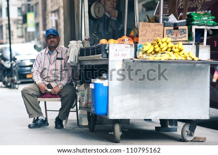 NEW YORK CITY - JUN 24: Food seller in NYC on June 24, 2012. New York City's food culture is influenced by the city's immigrant history. There are about 4,000 mobile food vendors licensed by the city.