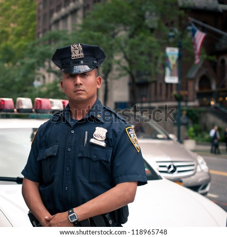 NEW YORK CITY - JUN 27: NYPD Police officer in NYC on June 27, 2012. The New York City Police Department (NYPD), established in 1845, is the largest municipal police force in the United States.