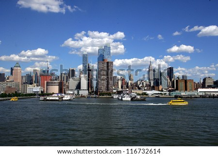 NEW YORK CITY - JUNE 23: A general view of midtown Manhattan taken from the Hudson River in New York City, on Saturday, June 23, 2012. - stock photo