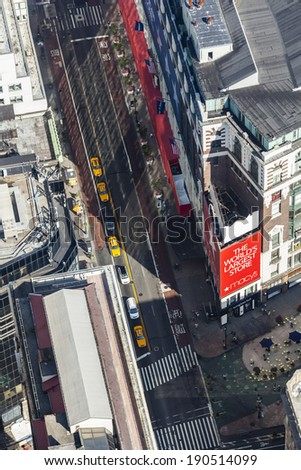 New York City - June 23: High angle view from Empire State Building into the streets of Manhattan with the large Macy\'s store, USA on June 23, 2013