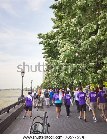 NEW YORK CITY - JUNE 5:  The American Liver Foundation holds a 3 mile walk Sunday June 5, 2011 to raise money.  Seen here, participants of the Liver Life Walk walk along the river in lower Manhattan, NY - stock photo