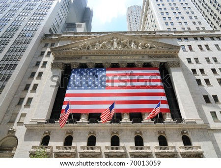 NEW YORK CITY - JUNE 4: The historic New York Stock Exchange on Wall Street with crowds below, one of the largest stock exchanges in the world June 4, 2010 in New York, New York.