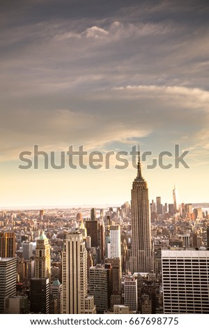 NEW YORK CITY - JUNE 24, 2017:   View of New York City skyline seen from midtown Manhattan looking downtown. This image has vintage tone filter.  #667698775