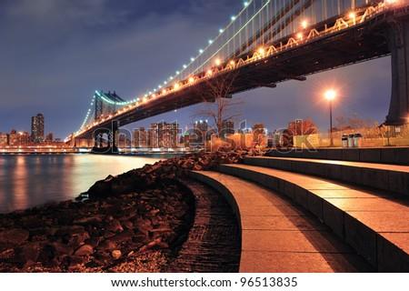 New York City Manhattan Bridge closeup with downtown skyline over East River. - stock photo