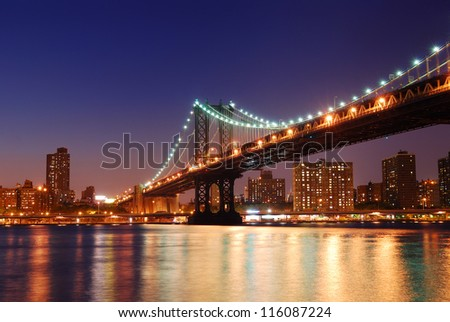 New York City Manhattan Bridge over Hudson River with skyline after sunset night view illuminated with lights viewed from Brooklyn. #116087224