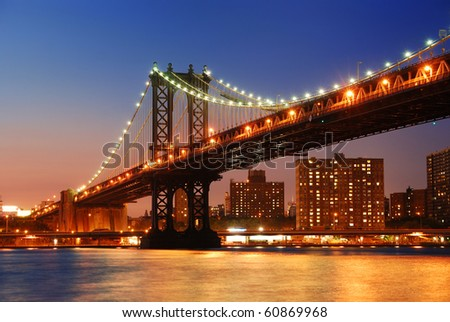 New York City Manhattan Bridge over Hudson River with skyline after sunset night view illuminated with lights viewed from Brooklyn. #60869968