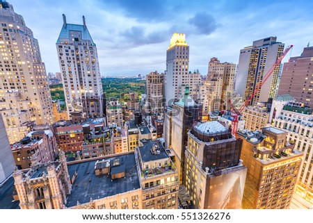 New York City. Manhattan buildings and Central Park at sunset, aerial view. #551326276