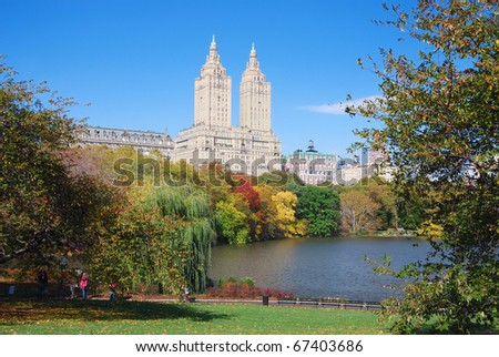 New York City Manhattan Central Park panorama in Autumn lake with skyscrapers and colorful trees over with reflection. - stock photo