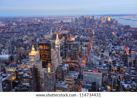 New York City Manhattan downtown aerial view at dusk with urban city skyline and skyscrapers buildings