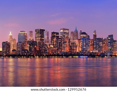 New York City Manhattan downtown skyline at dusk with skyscrapers illuminated over Hudson River panorama #129952676