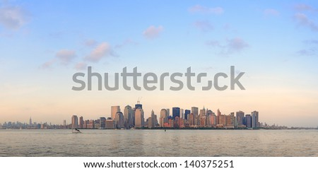 New York City Manhattan downtown skyline at sunset over Hudson River panorama