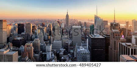 New York City. Manhattan downtown skyline skyscrapers at sunset.