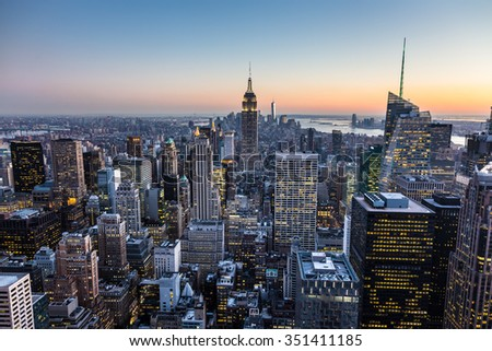 New York City. Manhattan downtown skyline with illuminated Empire State Building and skyscrapers at dusk. #351411185