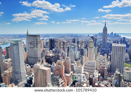 New York City Manhattan midtown aerial panorama view with skyscrapers and blue sky in the day.