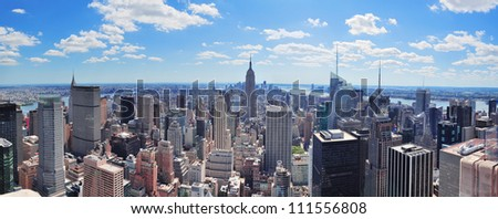 New York City Manhattan midtown aerial panorama view with skyscrapers and blue sky in the day. #111556808