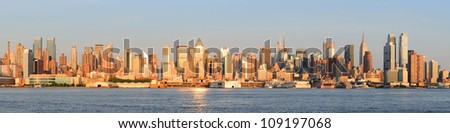 New York City Manhattan midtown skyline panorama at sunset.